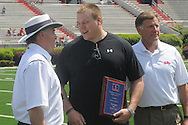 Reid Neely (center) is the receipient of the Clower-Walters Scholarship, presented during halftime of Mississippi's Grove Bowl in Oxford, Miss. on Saturday, April 17, 2010. Head coach Houston Nutt (left) and athletic director Pete Boone look on.