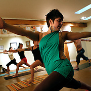 SHOT 7/3/11 2:20:31 PM - Giulia Pecone of Denver, Co. leads a free vinyasa yoga session at the prAna store in Boulder, Co. Boulder, Co. has long been  famous for residents who are über environmentally conscious, socially liberal, obsessively healthy and, at times, overly preachy about each. It also has been a haven for Eastern philosophy and thought including a 1,000-student Buddhist-inspired university, yoga studios and meditation centers by the dozens, scads of alternative medicine practitioners, authentic Himalayan restaurants and more Eastern import shops than you'd think a town of 100,000 could possibly sustain.  (Photo by Marc Piscotty / © 2011)