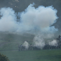 Confederate soldiers, surrounded by smoke from musket-fire and cannon-fire, work their way across the battlefield during a sunrise reenactment of Donelson's Attack, part of a weekend of events commemorating the 150th anniversary of the Battle of Perryville in Perryville, Ky. Saturday October 6, 2012.  Photo by David Stephenson
