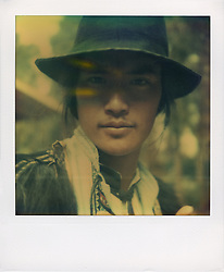 SX-70 Polaroid portrait of a man in traditional dress, Yunnan Province, China, Asia