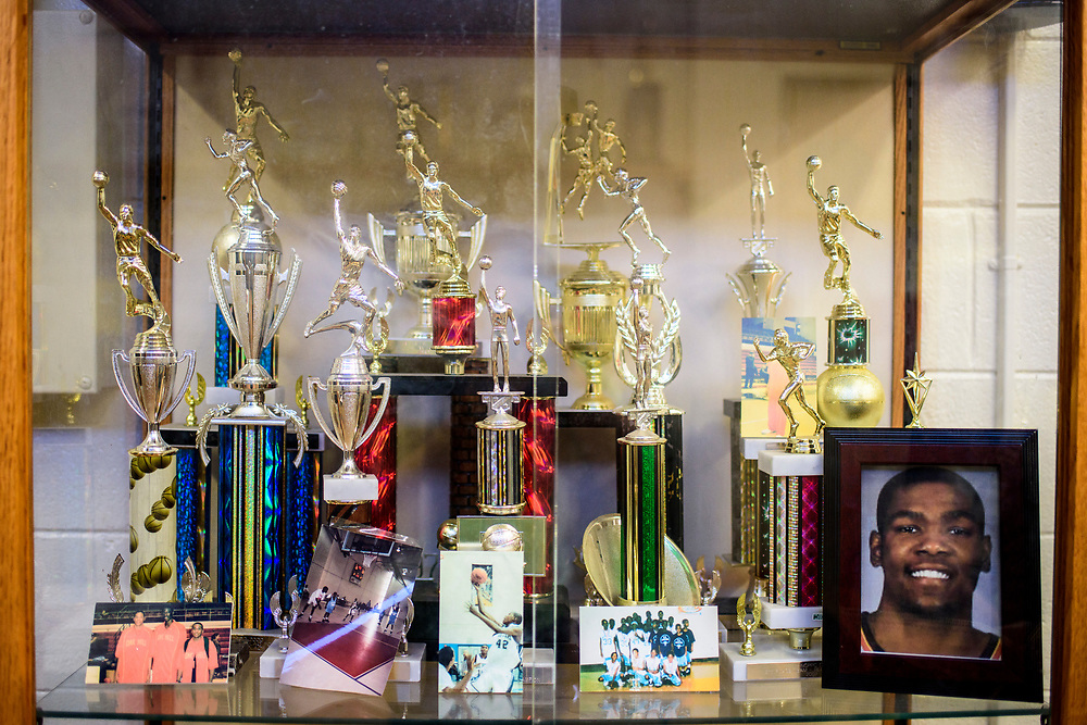 Capitol Heights, Maryland - March 29, 2017: A trophy case shows off the Seat Pleasant's competitive accomplishments in the Activity Center's Kevin Durant Den. NBA super star Kevin Durant has donated a substantial amount of money to help renovate the Seat Pleasant Activity Center where he learned to play basketball. Durant's AAU coach and mentor Charles &quot;Chuckie&quot; Craig, who worked at the Activity Center, was gunned down in May 2005 at the age of 35. Durant wears #35 in Craig's honor.<br /> <br /> <br /> NBA Superstar Kevin Durant's jersey number &quot;35&quot; is a tribute to his rec. league coach and mentor Charles &quot;Chuckie&quot; Craig, who was gunned down in at a night club in Laurel, Md., in 2005 when he was 35 years old. <br /> <br /> CREDIT: Matt Roth for The New York Times<br /> Assignment ID: 30204524A
