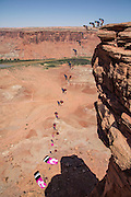 A composite image of Steph Davis Base jumping from a cliff above the Green River in Southern Utah.
