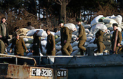 North Korean soldiers unload goods from a boat in the bank of the Yalu river in a in Sinuiju, North Korea on Wedenesday, Feb. 07, 2007. As The Six Party talks will resume on the 8th of February and the US hope to terminate North Korean nuclear program