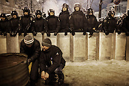 A squad of riot police surrounds a protester's camp the police forces to evacuate near the Presidential compound, on December 9, 2013 in Kiev, Ukraine. Thousands of protesters have taken to the streets since Ukrainian president Viktor Yanukovych announced a decision to suspend a trade and partnership agreement with the European Union and raised concerns that the nation could be poised to enter a customs union with Russia.