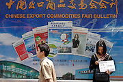 A Chinese woman hoping for Interpreter work from foreign businesses visting the Trade Fair in Guangzhou, southern China on Thursday, 14th, Apr. 2005.