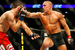 August 9, 2008; Minneapolis, MN, USA;  UFC Welterweight Champion George St. Pierre (black trunks) and challenger Jon Fitch (red trunks) battle during their bout at the Target Center in Minneapolis, MN at UFC 87: Seek and Destroy.  St. Pierre retained the Welterweight title via 5 round unanimous decision.