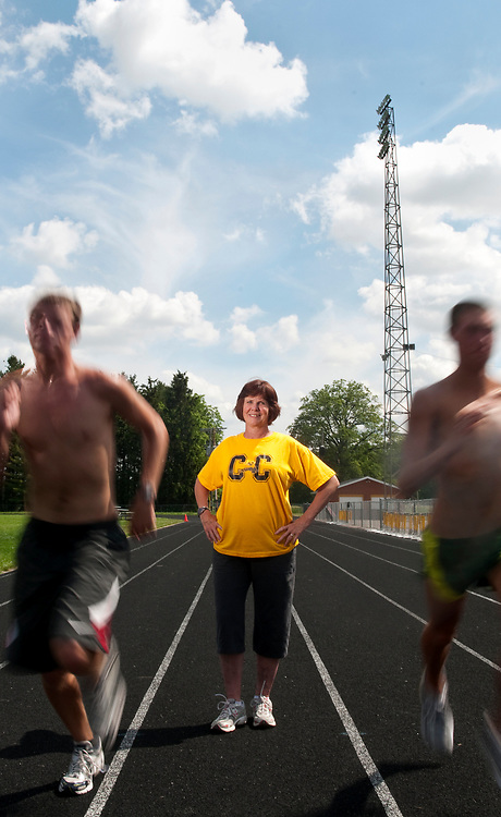 Colonel Crawford distance track coach Jody Grove has coached four state champions in the 1600 meter run during her time with the Eagles. This week Grove will take two miler Nathan Kemper, left, and defending state 1600 meter champion Carson Britton to the Division III regional track meet at Fairfield Union High School. (Rob Hardin / Telegraph-Forum)
