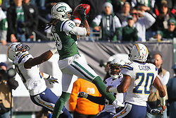Dec 23, 2012; East Rutherford, NJ, USA; New York Jets wide receiver Clyde Gates (19) catches a pass from New York Jets wide receiver Jeremy Kerley (11) while being defended by San Diego Chargers cornerback Antoine Cason (20) during the first half at MetLIfe Stadium.