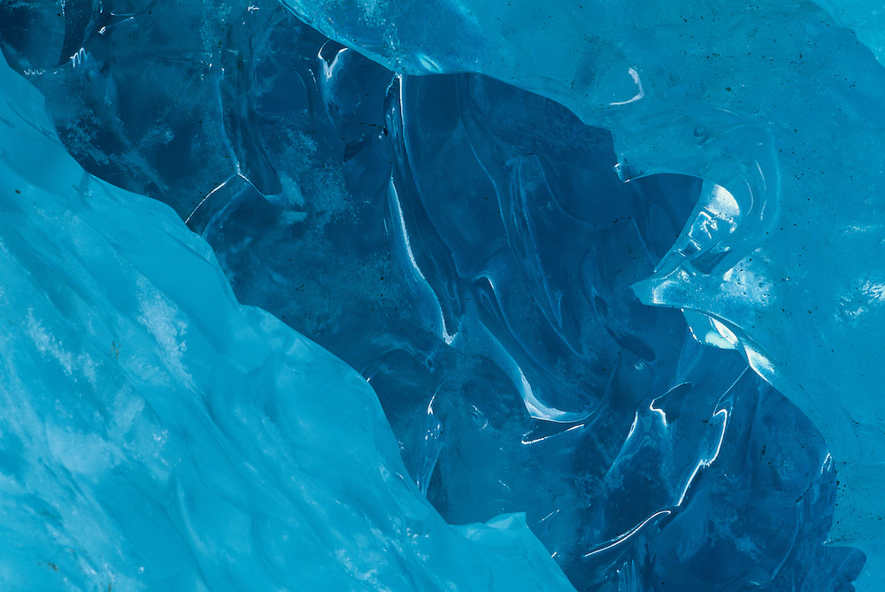 USA, Alaska, Kenai Fjords National Park, Melting water carves blue ice on Exit Glacier in late summer