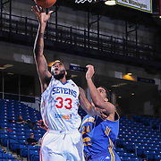 Delaware 87ers Forward Kenny Hall (33) drives towards the basket as Santa Cruz Warriors Forward James Michael McAdoo (24) defends in the first half of a NBA D-league regular season basketball game between the Delaware 87ers and the Santa Cruz Warriors (Golden State Warriors) Tuesday, Jan. 13, 2015 at The Bob Carpenter Sports Convocation Center in Newark, DEL