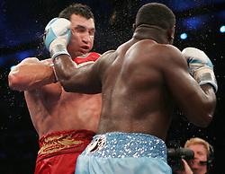 Wladimir Klitschko (l) and Samuel Peter (r) trade punches during their fight Saturday night at Boardwalk Hall in Atlantic City, NJ.  Klitschko won via 12 round unanimous decision.