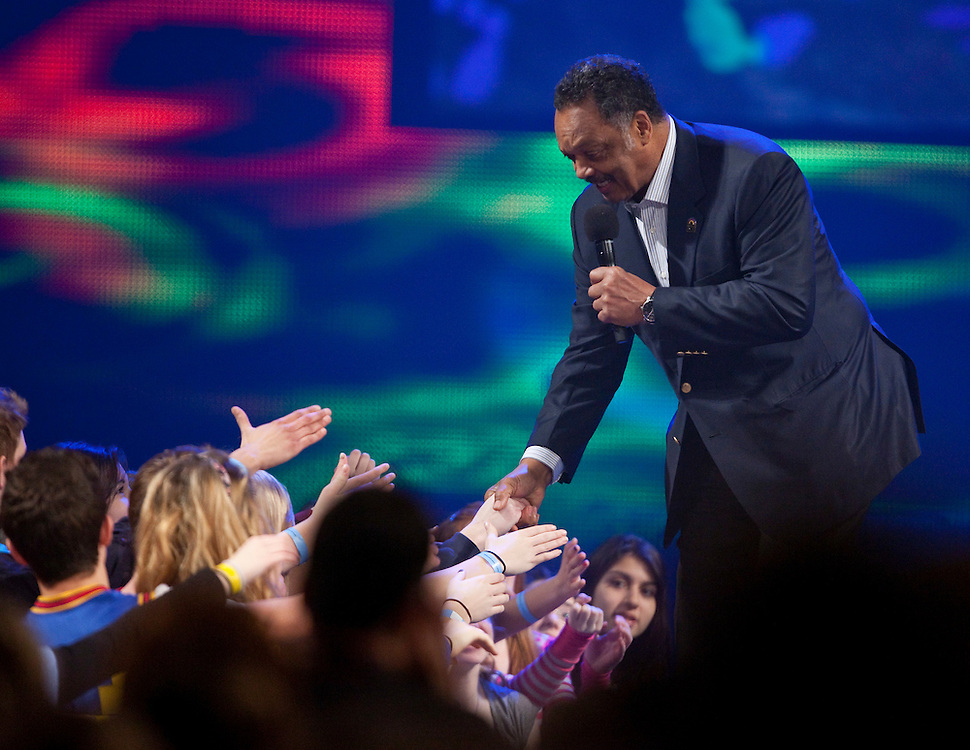 Reverend Jesse Jackson shakes hands with the audience of young people at Free the Children's We Day celebrations in Kitchener, Ontario, February 17, 2011. We Day was started to celebrate the power of young people. <br /> The Canadian Press/GEOFF ROBINS