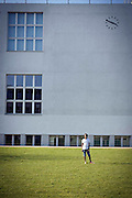 A student stands in front of the elementary school in Bienne, Switzerland. Image © Angelos Giotopoulos/Falcon Photo Agency