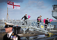 Sailors with bunches of flowers disembark the type 23 frigate HMS Richmond after returning to Portsmouth Royal Navy Base following a seven-month deployment to the South Atlantic. Picture date: Friday 21st February, 2014. Photo credit should read: Christopher Ison. Contact chrisison@mac.com 07544044177