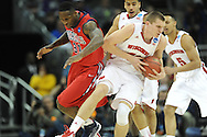 Ole Miss' Murphy Holloway (31) vs. Wisconsin's Jared Berggren (40) in the NCAA Tournament at the Sprint Center in Kansas City, Mo. on Friday, March 22, 2013.