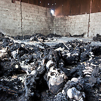 The remains of some 50 bodies that were burnt in a warehouse sometime in the last few days in Tripoli, Libya. According to press reports the victims are believed to be Libyan civilians arrested by pro-Gaddafi loyalists for interrogation. As the Libyan rebel forces were advancing, the pro-Gaddafi forces acted to cover up the bodies of the people they were interrogating, they threw in grenades and then had subsequently set fire to tyres inside of the warehouse to cover up the bodies, locals said. August 2011.