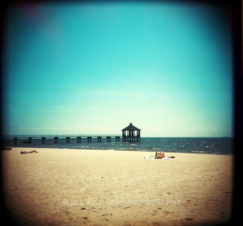 Sunbathers on the beach at Lake Pontchartrain. Shot on film with a Holga camera.