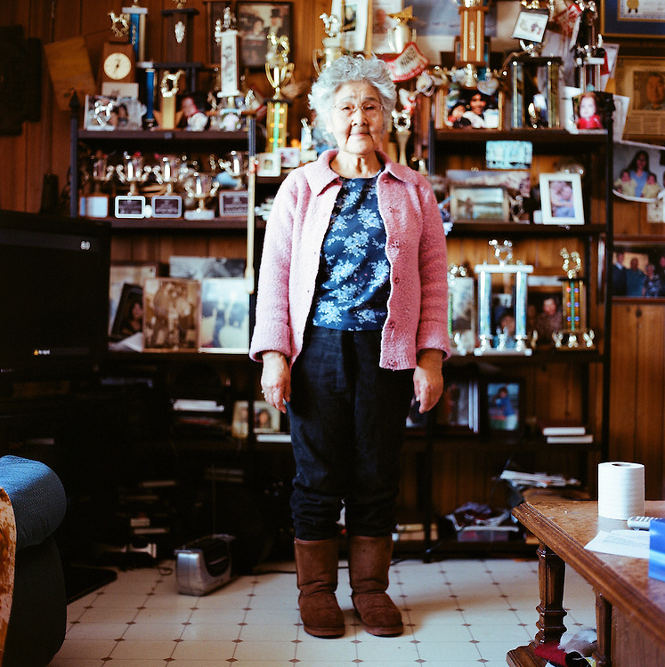 Elizabeth Nayokpuk, wife of the late Iditarod legend Herbie Nayokpuk, in her home in Shishmaref, Alaska. Elizabeth was one of the original contributors to the 1951 Eskimo Cookbook, and still prepares traditional Native dishes today. On the day of our visit, Elizabeth was preparing a roast from caribou hunted by her son.