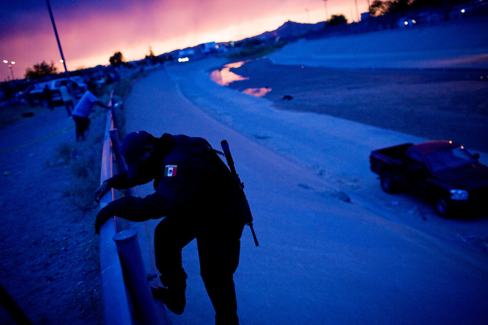 A Mexican Federal officer at the scene of the shooting of a 15 year-old boy, who was killed by a U.S. Border Patrol agent in Ciudad Juarez, Chihuahua on June 7, 2010 after he had tried to cross.