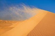 Wind blowing sand off dune, Namib-Naukluft National Park, Namibia