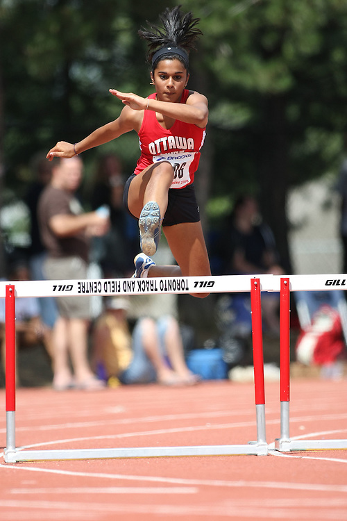 (Toronto, Ontario---2 August 2008)  Devyani Biswal competing in the midget girls 200m hurdles at the 2008 OTFA Supermeet II, the Bantam, Midget, Youth Track and Field Championships. This image is copyright Sean W. Burges, and the photographer can be contacted at www.msievents.com.