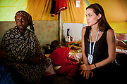 Tunisia: UNHCR Goodwill Ambassador, Angelina Jolie, visits Somali refugees at Shousha Camp, located in 8 kilometres from the Tunis-Libyan boder at Ras Djir. <br /> <br /> On 24 February UNHCR established its presence in Tunisia&rsquo;s southern village of Ras Djir to respond to the mass influx of people crossing into Tunisia to escape the violence in Libya. According to the Tunisian authorities, more than 200,000 have fled Libya to Tunisia since 20 February with more than 150,000 being third-country nationals. While most of the arrivals have been from Egypt, more than twenty-five others nationalities have been seen at the border, including a large number of Bangladeshis, Egyptians, Somalis and Sudanese. The majority of arrivals are migrant workers who were employed in Libya before the violence split the country. Yet, among the new arrivals many are persons of concern to UNHCR and therefore in need of international protection, including asylum seekers and refugees. UNHCR is on site to conduct protection interviews, counsel and to meet with its persons of concern for the purpose of exploring potential durable solutions. <br /> <br /> While more than 120,000 people have been repatriated to their country of origin, including, among others, Egyptians, Bangladeshis, Malians and Ghanaians, UNHCR in coordination with local authorities and other humanitarian agencies has established a tented transit camp in Shousha area, some 8 km north of the Tunisia border with Libya. As of 03 April, the total population at Shousha camp is approximately 8,700 with the majority of the residents originating from Chad, Sudan and Somalia. Two additional camps were set up to welcome migrants and refugees: one managed by the UAE Red Crescent and the other by IFRC (not yet operational).<br /> <br /> In comparison to the beginning of the crisis where more than ten thousand persons were crossing into Tunisia per day, currently, a daily average of 1,500 &ndash; 2,500 individuals continue to cross the border from Libya. It is estimated that wi