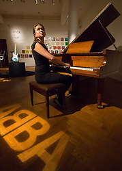 London, September 24th 2015. Representing the centrepiece of Sotheby's Rock and Pop exhibition, the Abba piano is expected to fetch betweem £60,000-800,000 at auction. It features in Sotheby's Rock and Pop exhibition running 24th - 28th September ahead of an auction on September 29th. The exhibition gathers together lyrics, instruments, stage costumes and artworks from some of the world's greatest pop and rock performers and groups, including Abba, The Beatles, Bob Dylan, Pink Floyd and Bruce Springsteen.