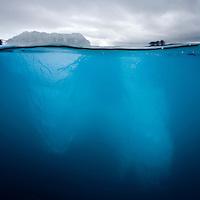 Norway, Svalbard, Spitsbergen, Underwater view of iceberg floating near face of Lilliehøøk Glacier in Lilliehøøkfjorden in Krossfjorden on summer morning