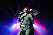 Frontman Justin Hawkins of The Darkness performs live on stage at HMV Hammersmith Apollo on November 25, 2011 in London, United Kingdom.  (Photo by Simone Joyner)