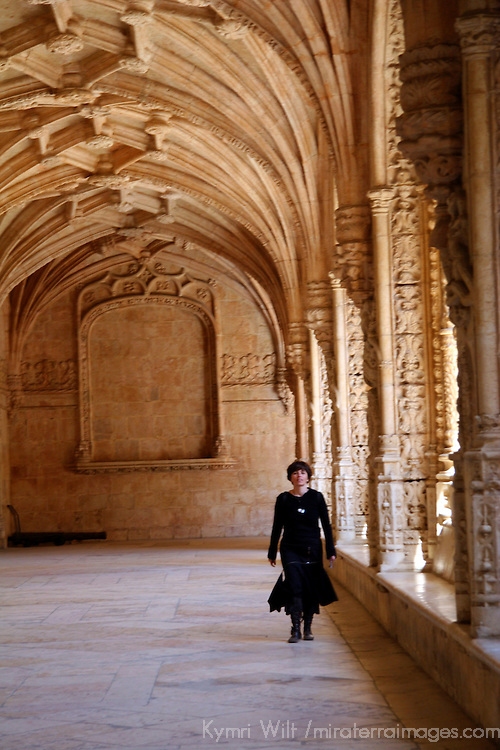 Europe, Portugal, Lisbon. Woman walking in Jerónimos Monastery in the district of Belem, a UNESCO World Heritage site.