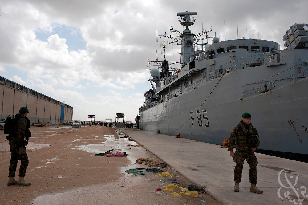 Royal Marines from the British Royal Navy frigate HMS Cumberland take up security positions during an evacuation mission of UK, EU and United States citizens February 27, 2011in Benghazi, Libya. Most Western countries have closed their embassies in Libya, and have advised citizens that they should leave the country while they still can..Slug: Libya.Credit: Scott Nelson for the New York Times