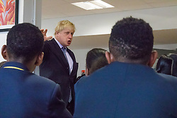 Michaela Community School, Wembley, London, June 23rd 2015. Mayor of London Boris Johnson visits the Michaela Community School, a Free School in Wembley that started taking students in September2014 after battling a certain amount of resistance from locals and unions. During the visit Head Teacher Katharine Birbalsingh took the Mayor on a tour of the school before he participated in a history lesson, prior to sitting down with pupils for brunch. PICTURED: Boris Johnson addresses pupils after brunch