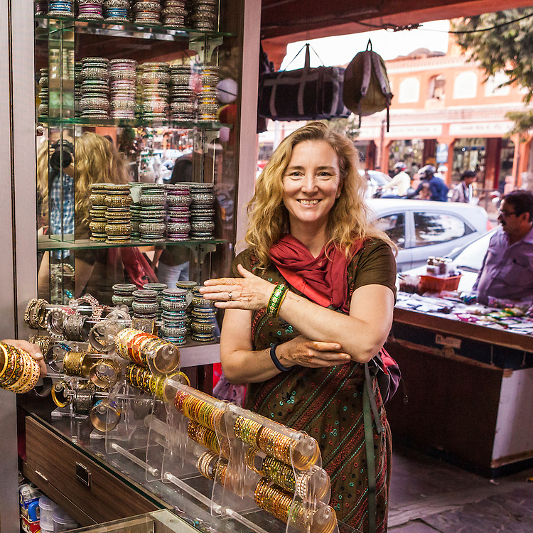 A woman posing for a picture in a bangle store in Jaipur, India.