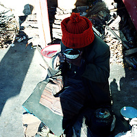 """MEILI MOUNTAIN, DECEMBER 17, 2000: a Tibetan nomad eats tsamap at Feilai monastery near Mt. Meili in the morning in deqin county, Yunnan province , December 17, 2000..Mt. Meili is the highest peak in Yunnan province and according to supporters from Deqin county, it's a """"proof"""" that the 'real"""" Shangri-La is located in deqin county. The fictuous Mt. Karakal which is described in James Hilton's Lost Horizon, alledgedly is modelled on Mt. Meili in Yunnan province.."""