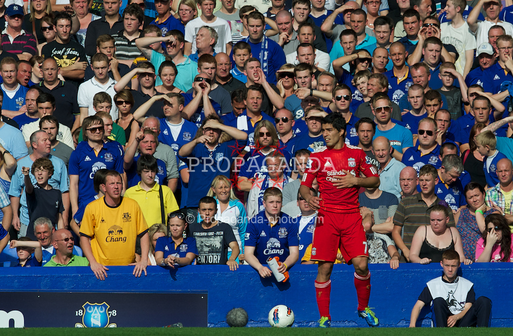 LIVERPOOL, ENGLAND - Saturday, October 1, 2011: Everton supporters hurl abuse at Liverpool's Luis Alberto Suarez Diaz during the Premiership match at Goodison Park. (Pic by David Rawcliffe/Propaganda)