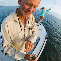 Fishing guide shows a small trout caught on the Laguna Madre off the Texas Gulf Coast.