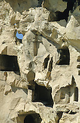 Rock cut dwellings exposed by erosion and rock fall. Cappadocia, Turkey, 1994