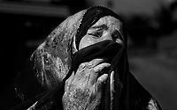 A local Iraqi woman cries after her husband is detained during Operation Brown Hawk in Tahrir, Iraq, on Feb. 27, 2007.