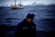 Vestfjorden, Nordland, Norway, 23.03.12..Skipper Steinar...The vessel Anne Marie with skipper Steinar Henriksen and (blue cap) brought out Team Olsen at the Arctic Cod fishing world championship. On the first day three man Team Olsen caught 1205 kilos of cod using nothing but fishing poles in the five hours of fishing time. The team; Geir L. Olsen (glasses), Magne Øvregård (white hat/red rainclothes) and Peder E. Vik (dark hair) won first prize this Friday in Lofoten Cup (Peder 1st, Magne 2nd and Geir 3rd)...Photo by: Eivind H. Natvig/MOMENT