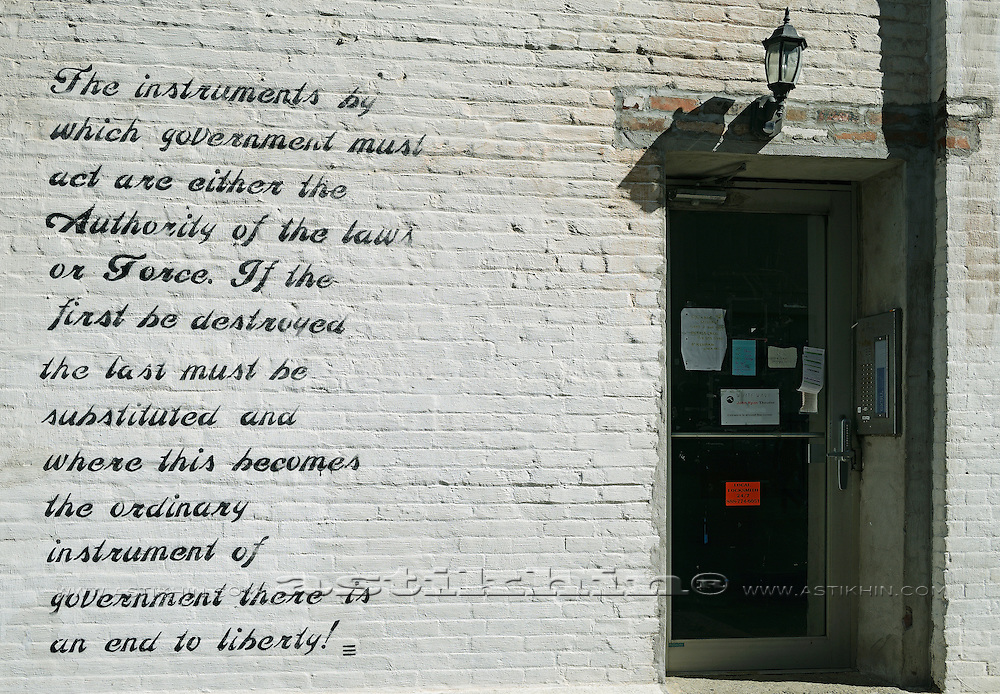 White brick wall with door.