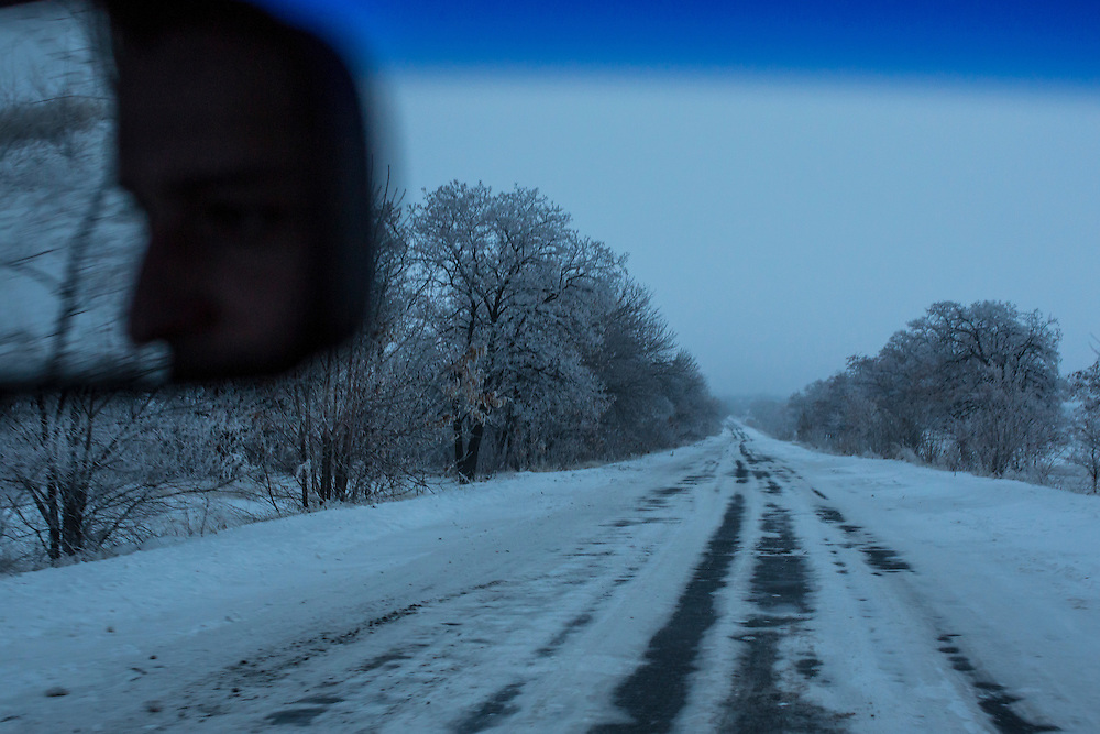 ALCHEVSK, UKRAINE - DECEMBER 8, 2014: A snow-covered road near Alchevsk, Ukraine. CREDIT: Brendan Hoffman for The New York Times
