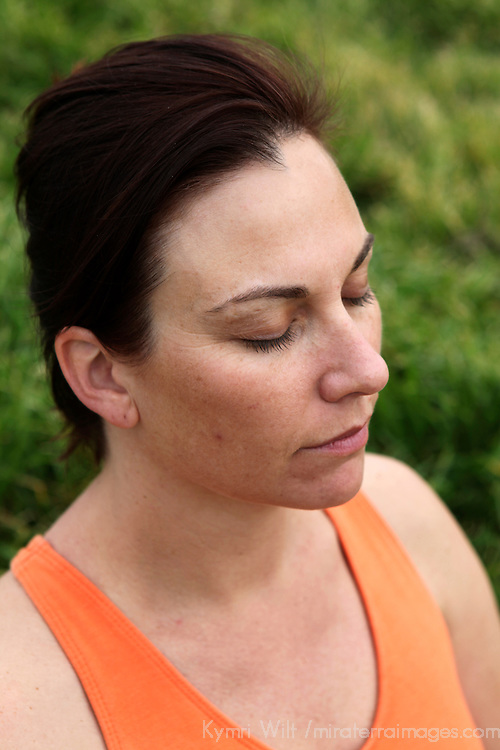USA, California. Natural healthy woman in her 40's outdoors, eyes closed in meditation.