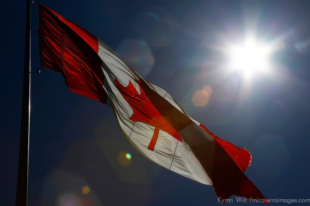 North America, Canada, Nova Scotia. Canada's Flag waves in a sunny blue sky.