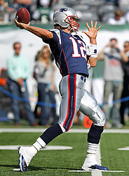 Sept 19, 2011; East Rutherford, NJ, USA; New England Patriots quarterback Tom Brady (12) throws a pass during the pre-game warmup for their game against the New York Jets at the New Meadowlands Stadium.