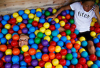 Sisters Natalie Brooks, 7 (L) and Katie Brooks, 9 of Boxford, MA play in the ball pit of the pirate themed Children's Center playground at the Wequassett Resort and Golf Club in Chatham, Massachusetts on July 12, 2012.   The upscale resort has a number amenities and programs geared towards children including a play center with a pirate themed playground, scavenger hunts, bonfires, and cooking classes. CREDIT: Matthew Healey for The Wall Street Journal.       .HOTELKIDS - Wequassett