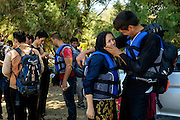 Couple in a happy moment after their safe arrival. <br /> Refugees arriving on beaches near Molyvos village in Lesvos island. Thousands of them come from Turkey, crossing the sea border on inflatable dinghy boats, on a dangerous trip that has claimed many lives. Local people or NGOs expect them and help them in some places but after their arrival, most of them have to walk to the nearest village where they can hope for a places on busses that can take them to the city of Mytilene where they can register and eventually board on a ferry to Athens. Many decide to walk the distance as the busses aren&rsquo;t enough to accommodate the large number of people that arrive daily.