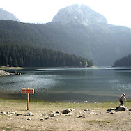 Lake in Durmitor park. There are several arguments about the derivation of the name  &quot;Montenegro&quot;, one of these relates to dark and deep forests  that once covered the Dinaric Alps, as it was possible to see them from the sea. <br />