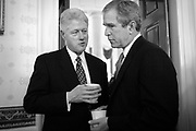 Clinton and Bush talk in the pre-inaugural coffee in the White House.
