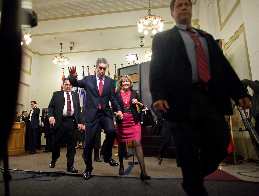 Liberal leader Michael Ignatieff trips as he and his wife Zsuzsanna Zsohar  leave a press conference following the english language debate in Ottawa, Ontario April 12, 2011.<br /> AFP/GEOFF ROBINS/STR