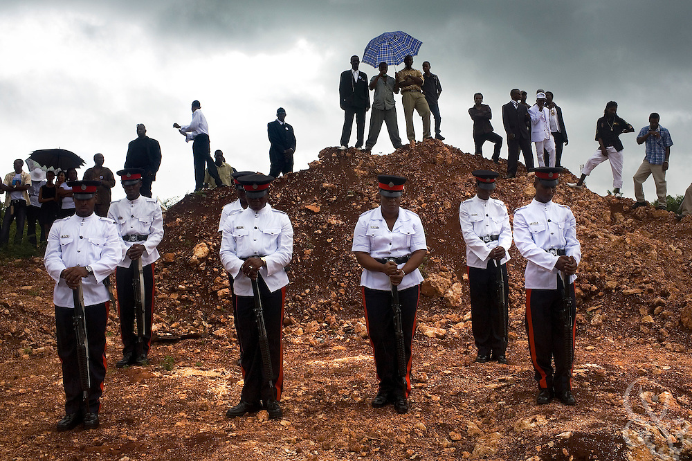 A Jamaican Constabulary Force (JCF) Honor Guard stands at attention during the funeral for slain officers Cornel Grant and Delano Lawrence June 15, 2008 funeral at the Dovecot Cemetery in Spanishtown, Jamaica. Delano and Grant were gunned down in an ambush in the inner city Trench Town area of Kingston while on patrol May 23, 2008.